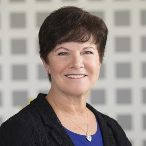 Ann Poland, Compliance Director