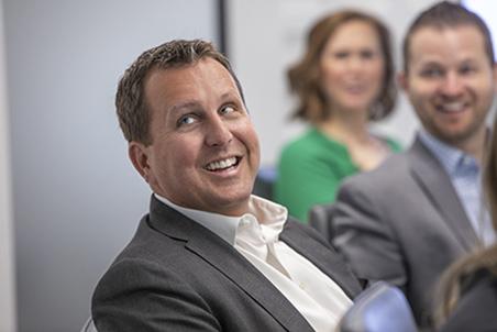 Jon Loftin in a board room meeting.