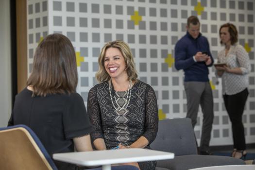 Rebecca Sterchi talking with fellow associate