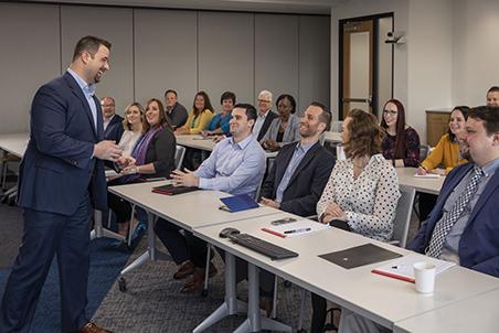 Ryan Michalowsk presenting to associates.